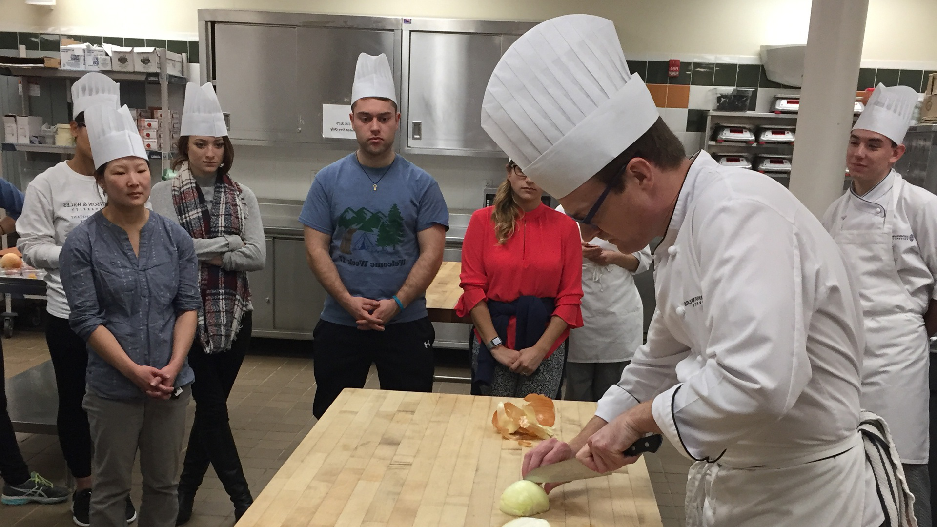 Todd Seyfarth demonstrates knife skills at the beginning of class.