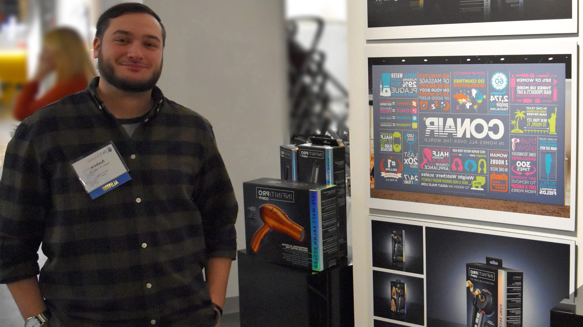 Andrew Calipa shows off his package design for the InfinitiPRO by Conair during the 2018 re-Connected alumni show.