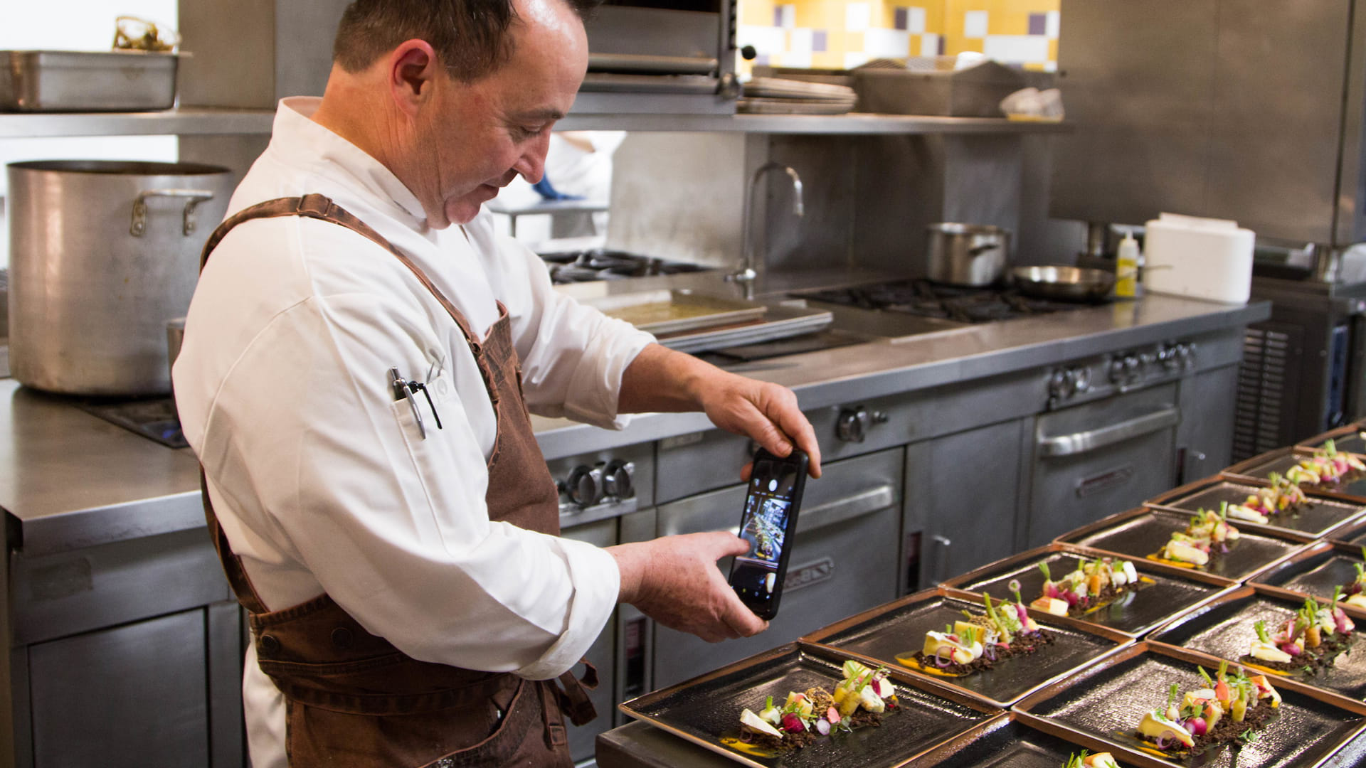 Chef Tom Condron '88 captures a final plate-up for Instagram.