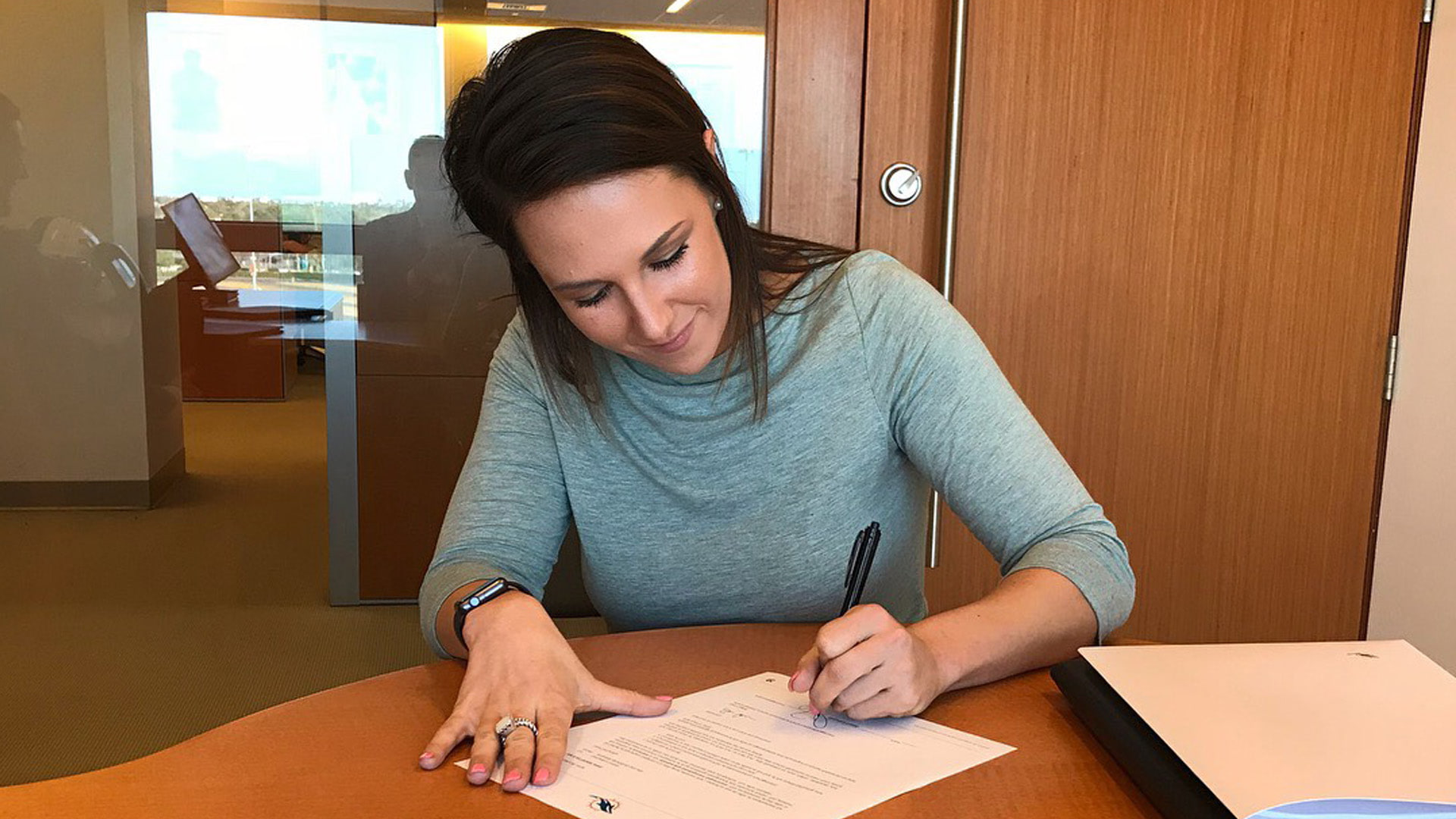 Samantha Creech signs with the Miami Dolphins.