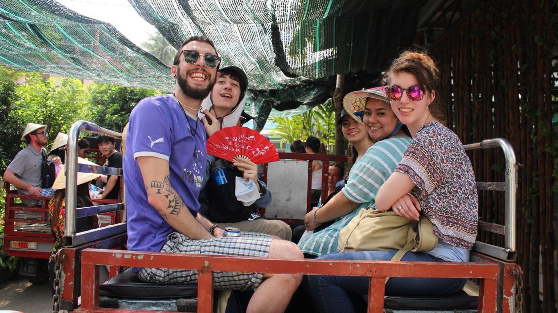 Julia (left) and students Cesia, Maria, Aren and Kyle experience a tuk-tuk ride in the islands of the Mekong Delta in Vietnam.