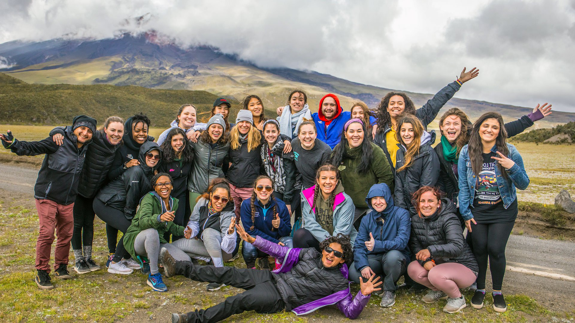 FAM Tour group in front of the famous, live Cotopaxi volcano