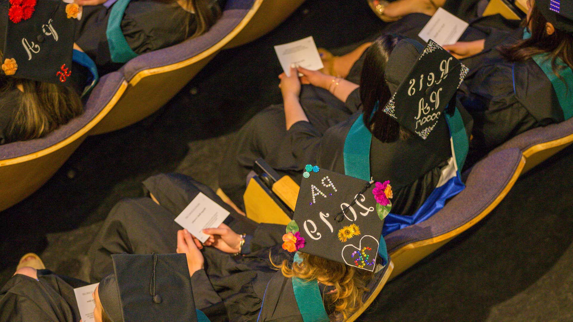Decorated mortarboards at 2019 CQ9电子游戏 PA Studies Commencement.