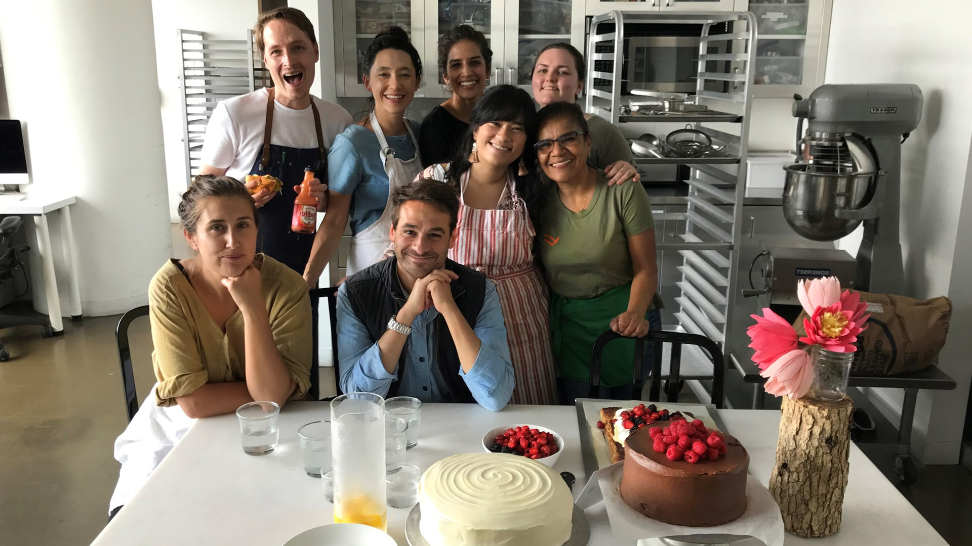 Kayla (center middle) with Kavita Thirupuvanam (far left), Thomas Joseph '06 (center front) and the rest of the Kitchen crew.