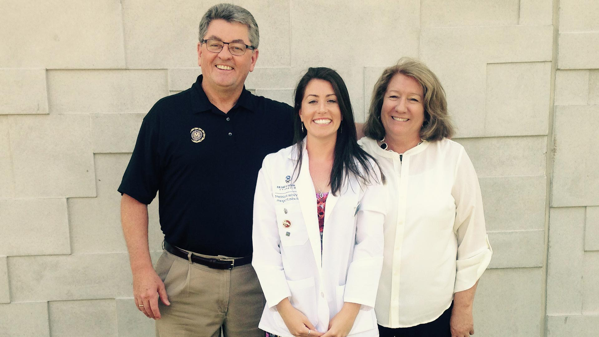 Heisler with parents at the White Coat Ceremony